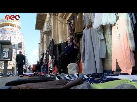 Georgian women work in clothes trade in Damascus