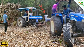 Powertrack Tractor Stuck With Sugarcane Trailer   New Holland 75 HP Tractor pulling out