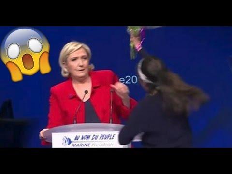 Marine Le Pen attaquée par une Femen au meeting de Paris.