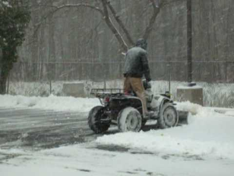 4 Wheel Drive Atv With Plow Blade Plowing Snow Youtube