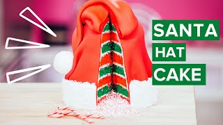 how-to-make-a-santa-hat-cake-red-green-vanilla-cake-with-white-chocolate-candy-cane-buttercream