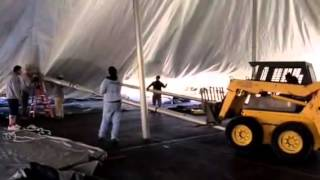 Installation of 80'x90' tent: Standing up center poles, rope and pole tent setup
