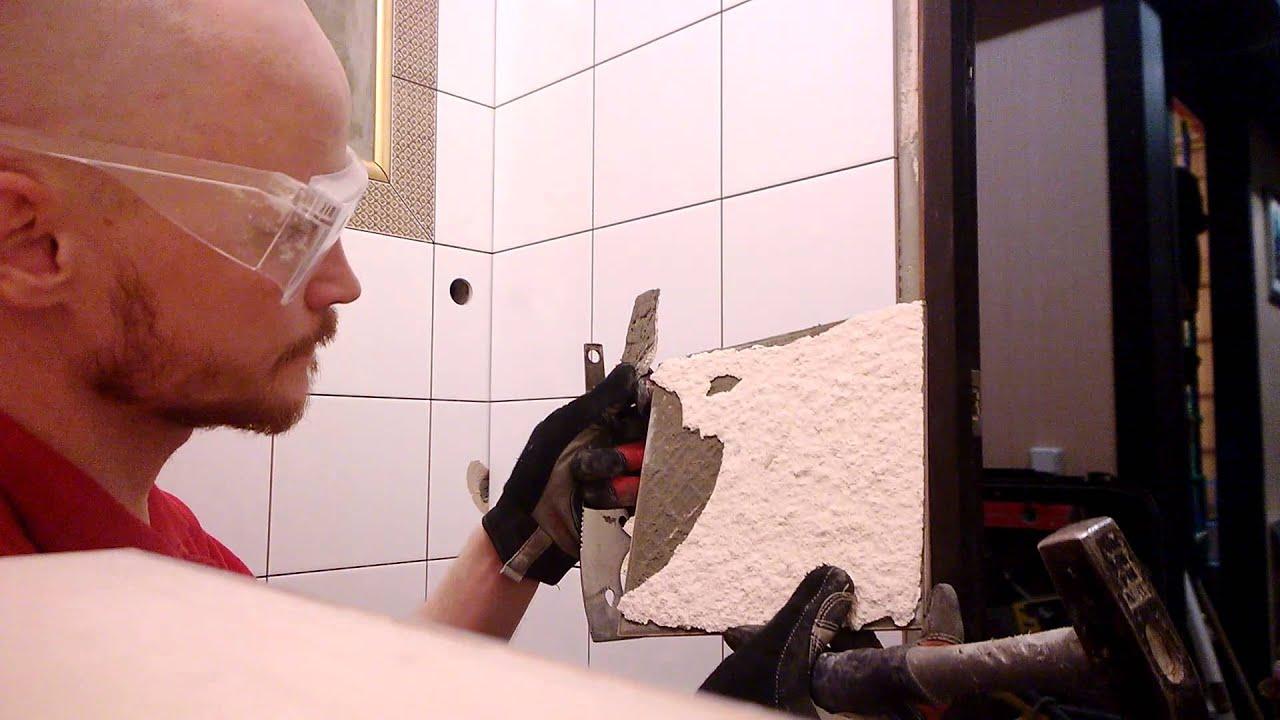Проверка качества приклеенной плитки к гипсовой штукатурке