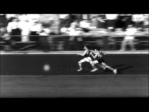 Glenn V. Cunningham defeats Archie San Romani during a race in Princeton, New Jer...HD Stock Footage