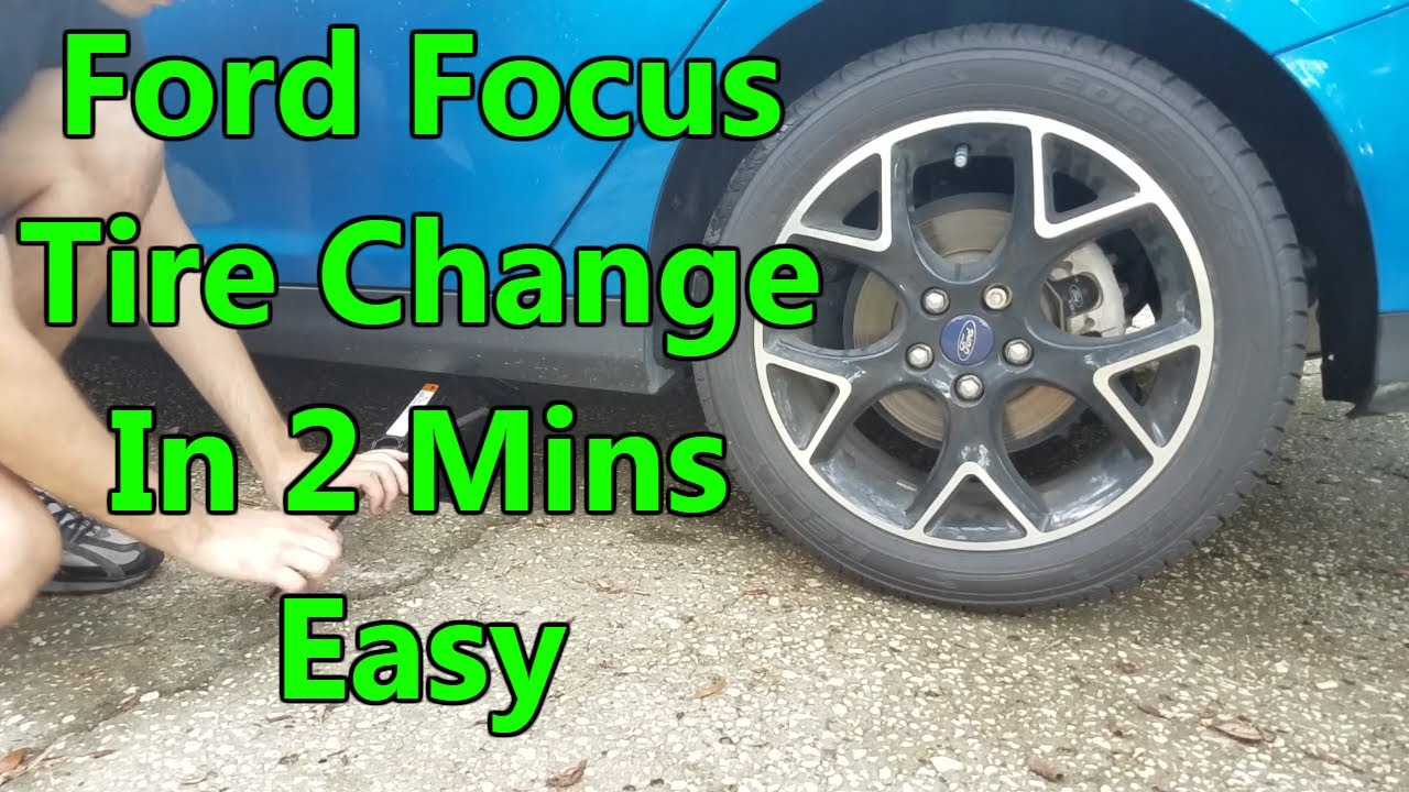 how to change a flat tire ford focus hatchback 2012 2016 [ 1280 x 720 Pixel ]