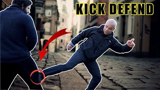 How do I defend against a kick to the nut knee or stomach?