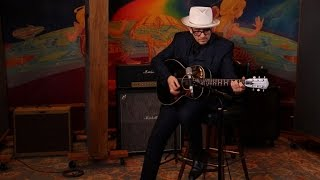 "Elvis Costello performs ""(The Angels Wanna Wear My) Red Shoes"""