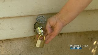 Padlocked spigot blocks squatters from water theft