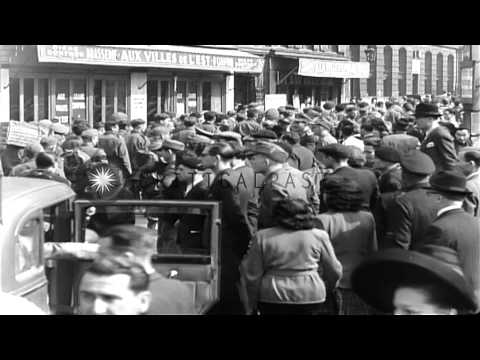 Group of American and British prisoners are marched through streets under German ...HD Stock Footage