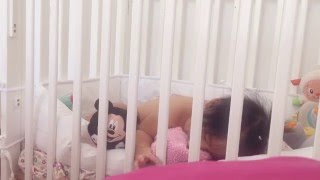 Cute chubby 10 months old baby falls asleep
