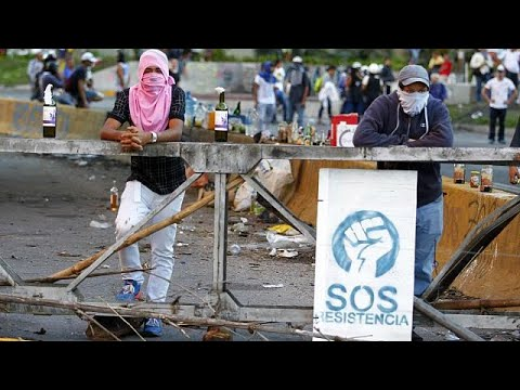 Violent clashes escalate on election day in Venezuela, leaving many dead
