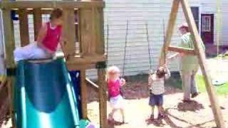 Kids Play On Swing Set
