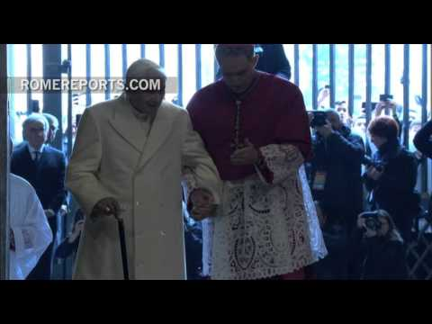 Pope Emeritus Benedict XVI walks through the Holy Door