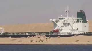a moment of passage of a giant ship within meters of drilling new channel