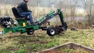 Kellfri towable ATV backhoe, towing and using in transport mode.