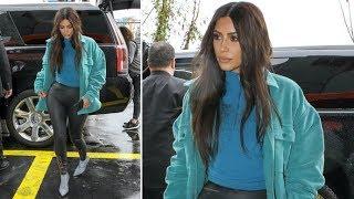 Kim Kardashian Stays Dry Wearing YEEZY Season 7 Scuba Leggings In The Rain