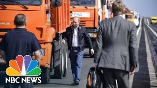 Truck-Driving Vladimir Putin Inaugurates 'Miracle' Bridge Between Russia And Crimea | NBC News