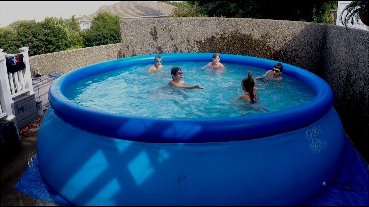 How to play swimming pool games in your backyard pool youtube for How much water is in a swimming pool