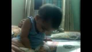 10 month old baby reading eenadu newspaper