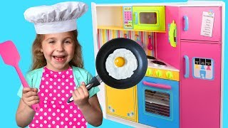 Nadia the cook plays with a toy Kitchen game set
