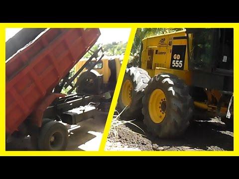 Grader GD555 Grading Gravel sands from Dumper Truck for new asphalt road