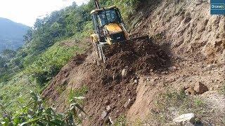 JCB Backhoe Loader Real-Clearing Land Slide in Hilly Region