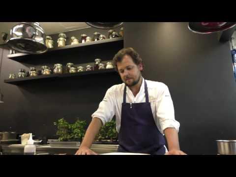 João Rodrigues prepares a pluma dish at restaurant Feitoria in Portugal