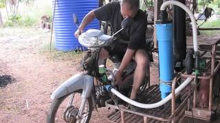 Green waste Charcoal Gasifier powering a moter bike, made in Thailand