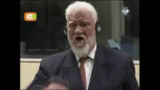 Bosnian Croat war criminal drinks poison in court