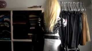 blondie in black and white leather pants and black trenchcoat black belt and black bag