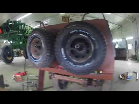 Double spare wheel carrier on 1986 F150 overland truck