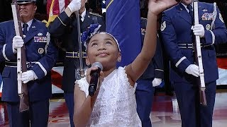 Six-year-old Victory Brinker sings the anthem before the Jazz game