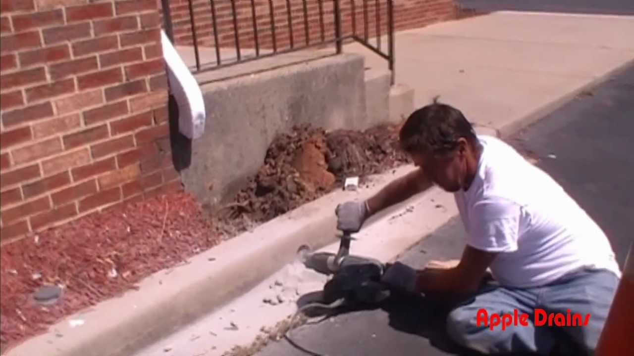 Drilling Curb Holes For Downspout Drain Apple Drains