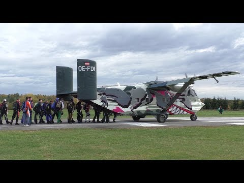Pink Skyvan Short SC-7 Skyvan landing and takeoff at Airfield Punitz + skydiver