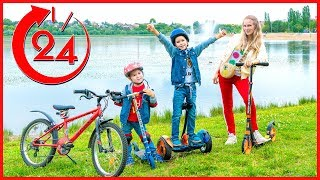 Kids ride on hoverboard, bike and scooter. Which is faster?