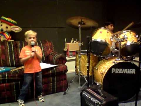 5 year Old drums and vocal student practicing All Shook Up with drum student Amit!