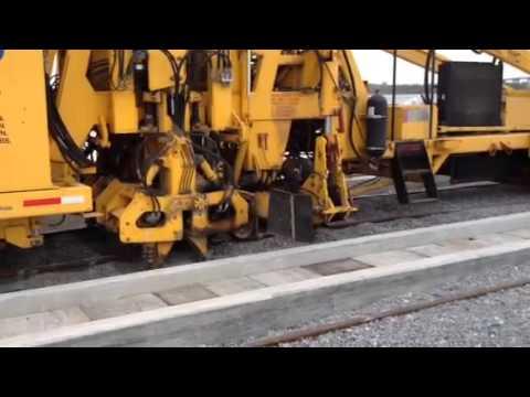 Rail track tamper unit