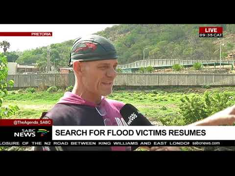 Search for flood victims resumes