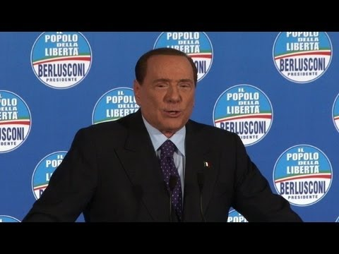 Berlusconi the showman fires up Rome election rally