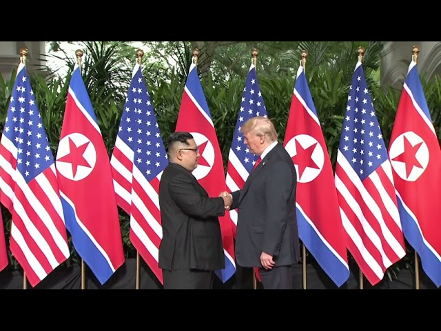President Donald Trump and North Korean leader Kim Jong Un are sharing an historic handshake as they meet for the first time. (The Associated Press)