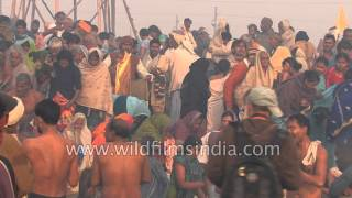 Indians bathe in the river Ganges during Kumbh Mela