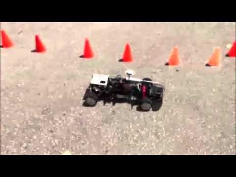Mini Autonomous Racing Car platform performing collision avoidance