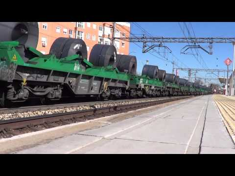 Renfe 253 locomotive with steel coils by San Cristobal Madrid