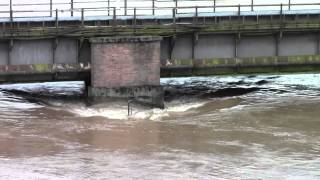 The River Severn battering this railway bridge at Over Jn