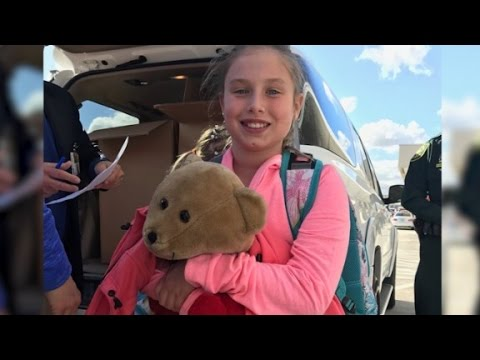 Girl, teddy bear reunited after airport attack