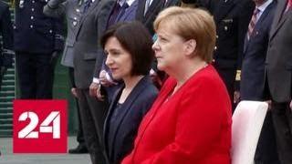 Меркель во второй раз прослушала гимн сидя - Россия 24