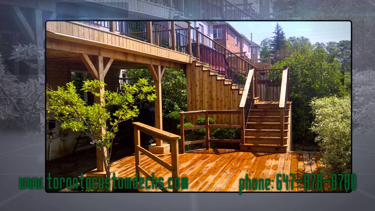 Cedar deck with pergola walkout patio and wrought iron railings