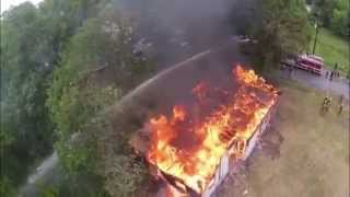 Drone films house burning down from the air