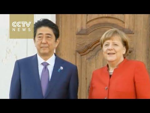 German Chancellor Merkel welcomes Japanese Prime Minister