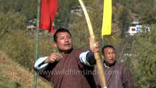 Archery training in Bhutan - traditional bamboo bow